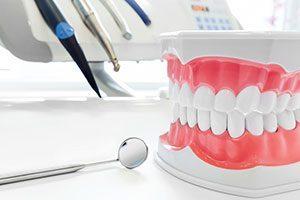 Set Of Dentures On Doctors Desk